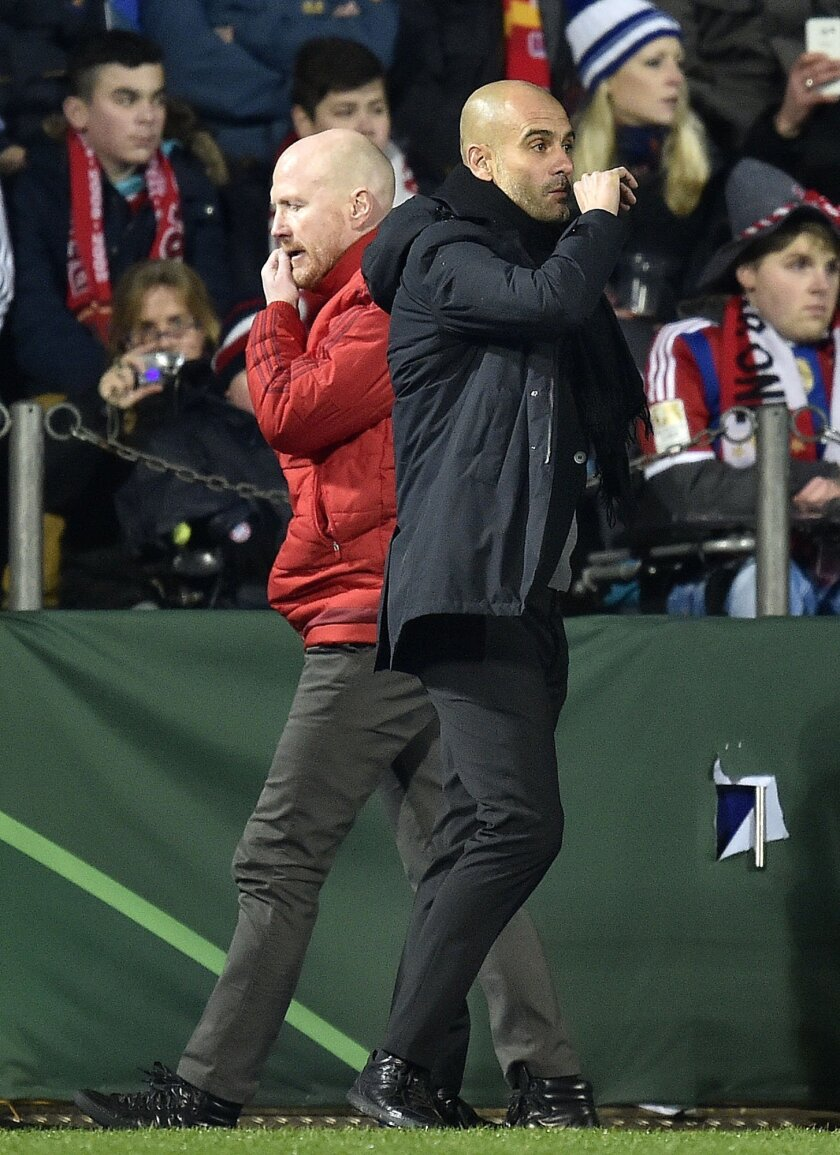 Bayern head coach Pep Guardiola and sport director Mathias Sammer, left, react disappointed during the German Soccer Cup quarterfinal match between VfL Bochum and Bayern Munich in Bochum, Germany, Wednesday, Feb. 10, 2016. (AP Photo/Martin Meissner)