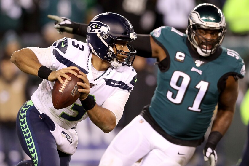 Seattle Seahawks quarterback Russell Wilson runs out of the pocket during Sunday's NFC wild-card win over the Philadelphia Eagles.