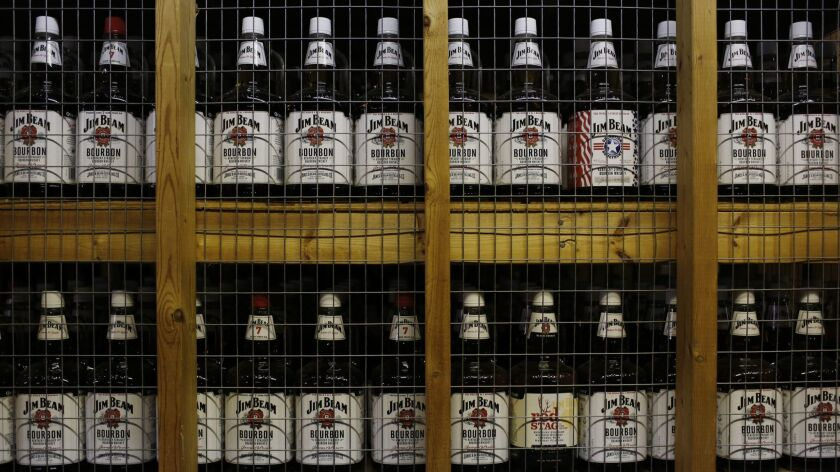 Bottles of Jim Beam Bourbon sit in storage at the Jim Beam Bourbon Distillery in 2014 in Clermont, Ky.