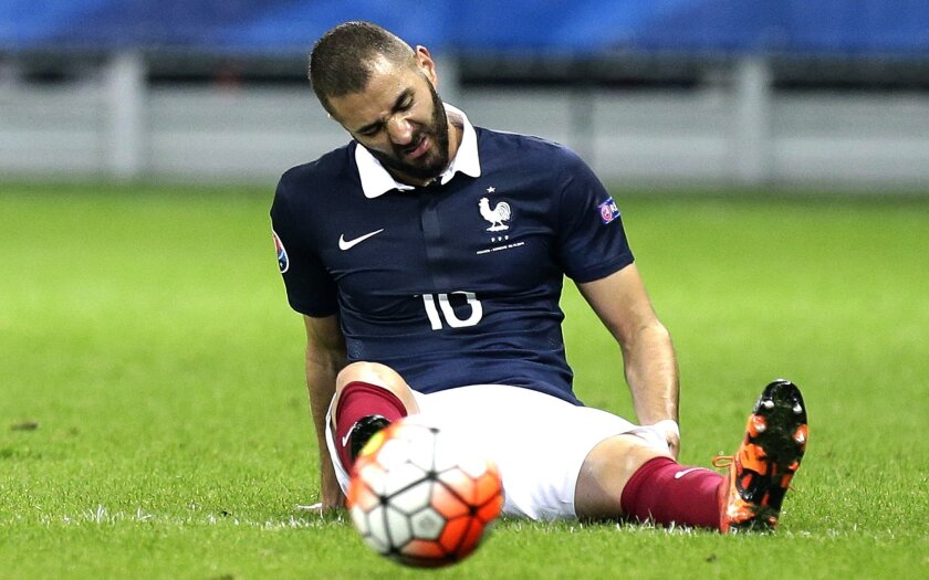 FILE - In this Oct.8, 2015 file photo, France's Karim Benzema, grimaces during the friendly soccer match against Armenia, in Nice, southeastern France.  Benzema has been charged Thursday Nov.5, 2015 with conspiracy to blackmail and participating in a criminal group as part of an investigation over