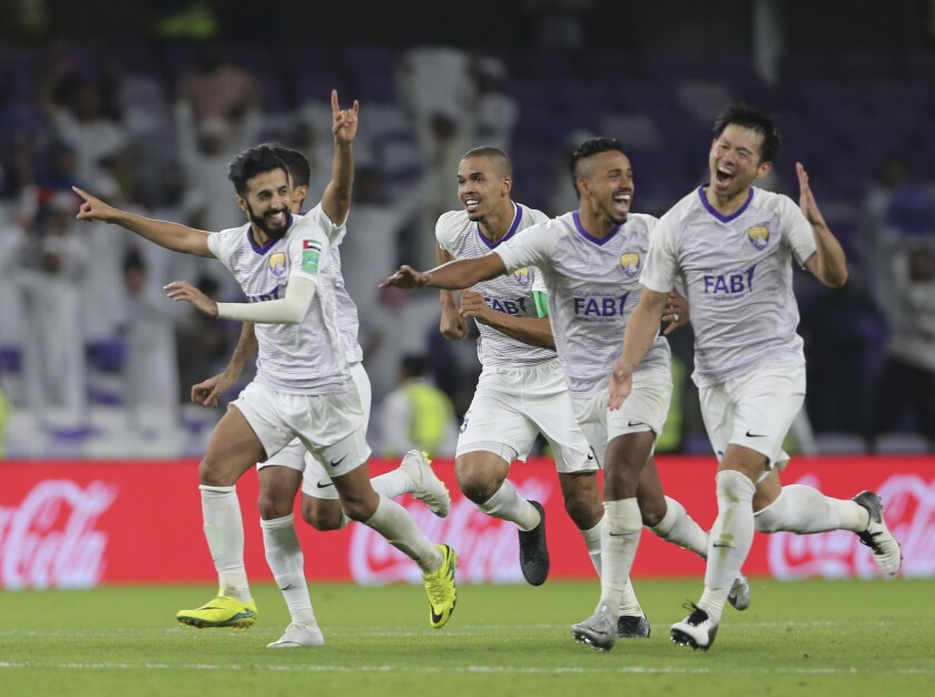 Al Ain players celebrate after winning a penalty shootout during the first round of the Club World Cup soccer match between Al Ain Club and Team Wellington at the Hazza Bin Zayed stadium in Al Ain, United Arab Emirates, Wednesday, Dec. 12, 2018.