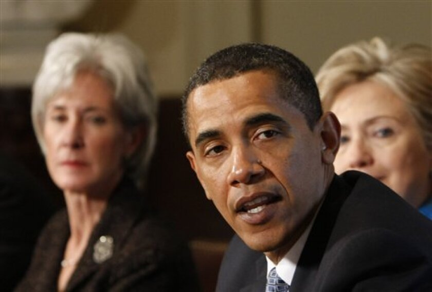 President Barack Obama meets with his Cabinet in the Cabinet Room of the White House in Washington, Friday, May 1, 2009. Left is Health and Human Services Secretary Kathleen Sebelius, and behind, partially visible is Secretary of State Hillary Clinton. (AP Photo/Gerald Herbert)