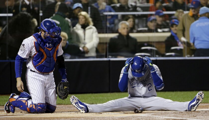 Kansas City Royals' Alcides Escobar reacts after nearly hit by a pitch during the first inning of Game 3 of the Major League Baseball World Series against the New York Mets Friday, Oct. 30, 2015, in New York. (AP Photo/David J. Phillip)