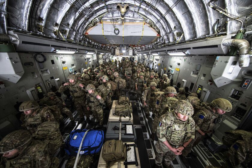 In this photo prvided by the Ministry Of Defence on Sunday, Aug. 15, 2021, British Forces from 16 Air Assault Brigade arrive in the Afghan capital of Kabul to assist in evacuating British nationals and entitled persons as part of Operation PITTING amidst the worsening security situation there. (Leading Hand Ben Shread/MOD via AP)