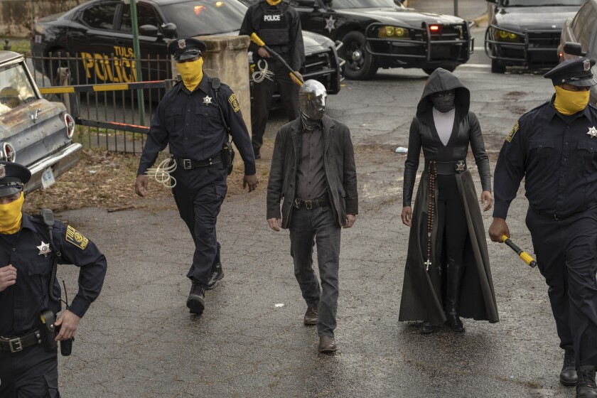 """Tim Blake Nelson and Regina King in a scene from """"Watchmen"""" on HBO."""