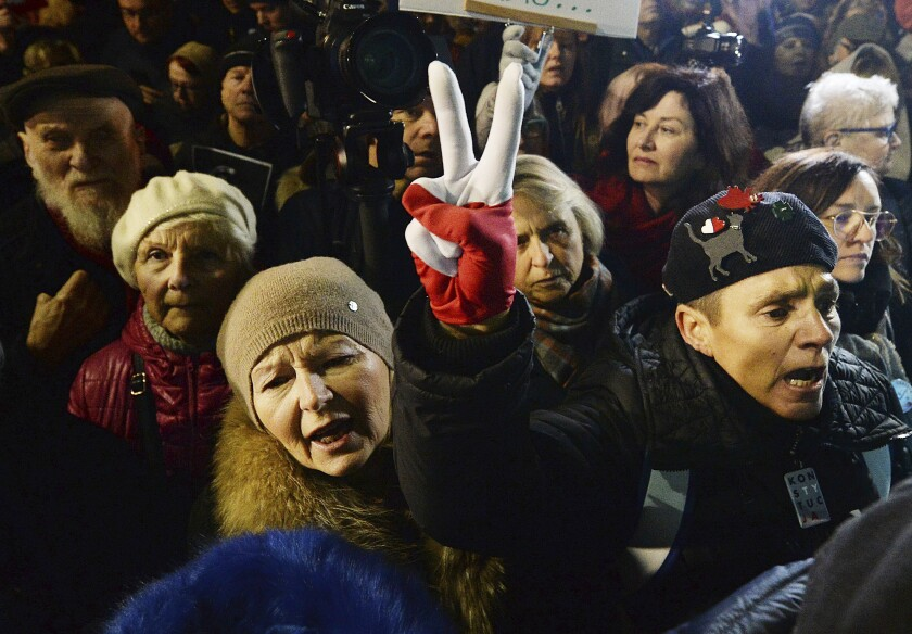 People take part in a street demonstration to show solidarity with judges facing increased political pressure from the country's right-wing government in Warsaw, Poland, Sunday, Dec. 1, 2019. (AP Photo/Czarek Sokolowski)