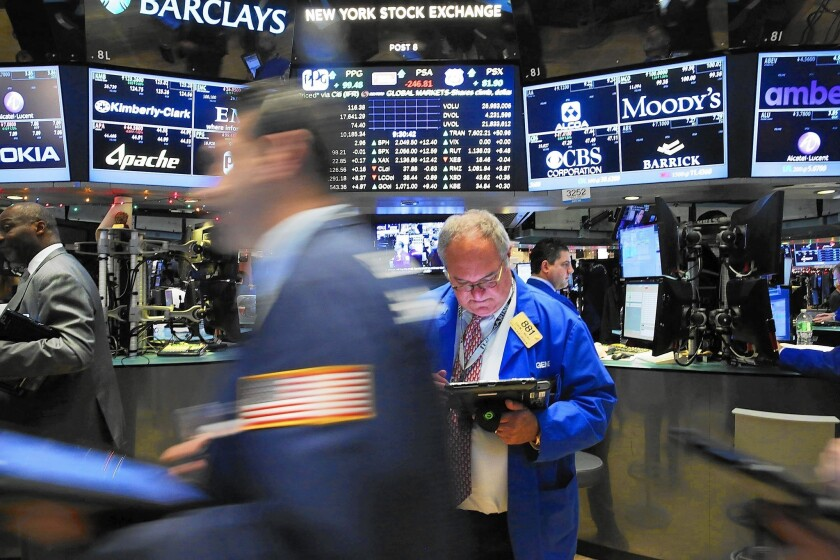 The Dow Jones industrial average slipped 2.2% for the year after falling 178.84 points on Thursday to close at 17,425.03. It was the Dow's first annual loss since the crash year of 2008. Above, traders at the NYSE.