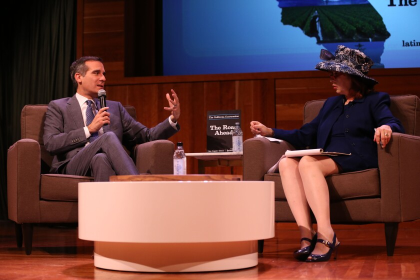 "Los Angeles Mayor Eric Garcetti speaks with Patt Morrison during the Los Angeles Times' ""The Road Ahead"" California Conversation transit panel at the Mark Taper Auditorium on Monday."