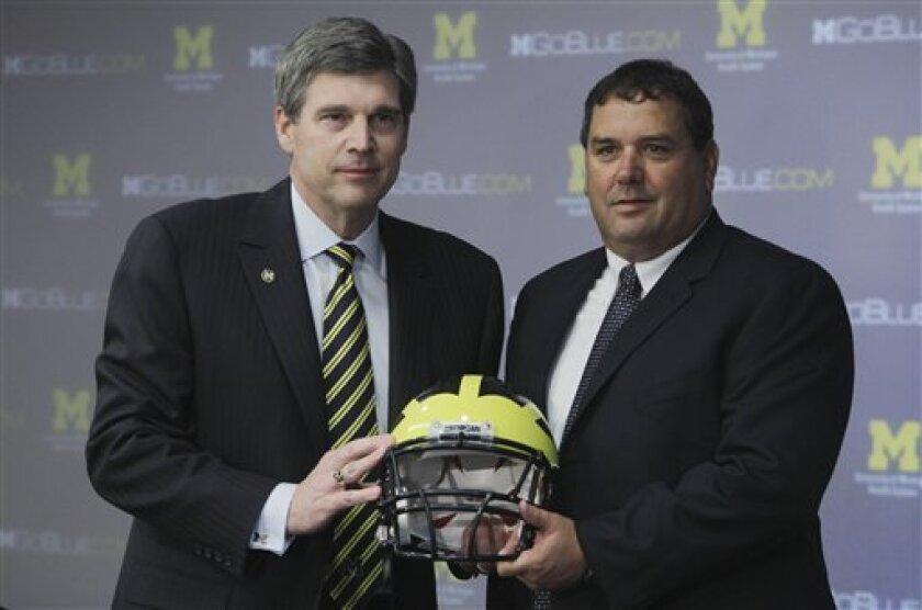 Michigan Athletic Director Dave Brandon, left, with new head football coach Brady Hoke.