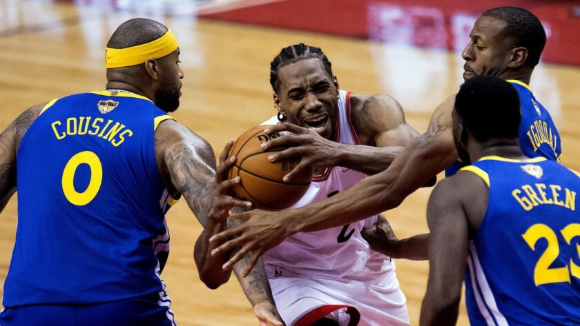 Toronto Raptors forward Kawhi Leonard (2) draws a foul as he drives to the net against Golden State