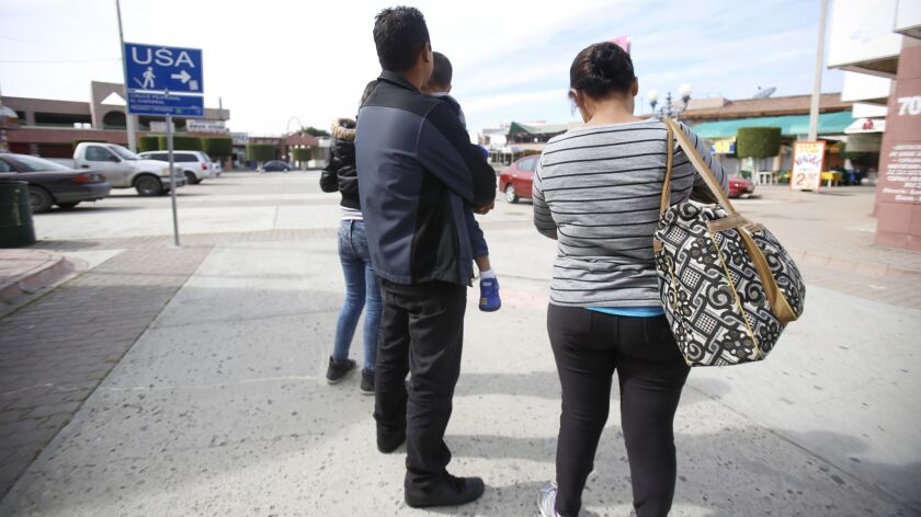 Attorneys and asylum seekers in attempt to request asylum at San Ysidro port of entry.