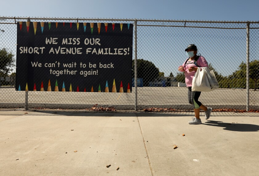 "A sign states, ""We miss our Short Avenue Families,"" at the closed Short Avenue Elementary School in Mar Vista."