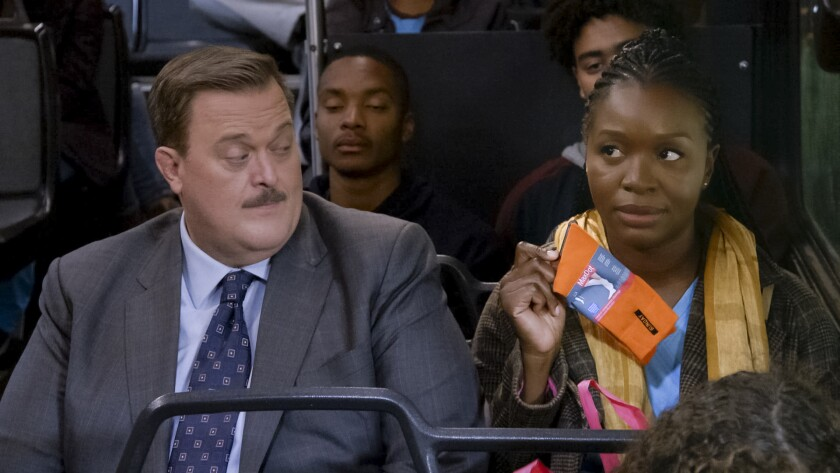 "Billy Gardell and Folake Olowofoyeku in the CBS series ""Bob Hearts Abishola."""