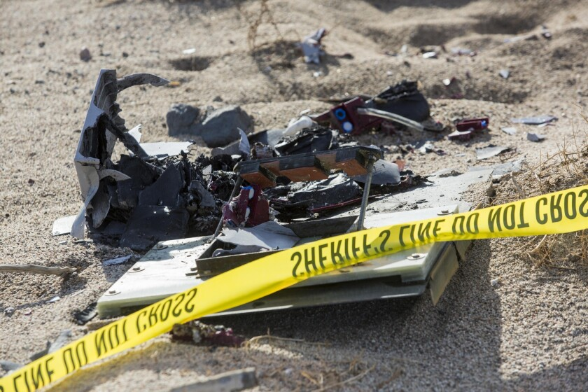 Wreckage lies near the site where a Virgin Galactic space tourism rocket, SpaceShipTwo, exploded and crashed in Mojave, Calif. The explosion killed a pilot aboard and seriously injured another while scattering wreckage in Southern California's Mojave Desert, witnesses and officials said.