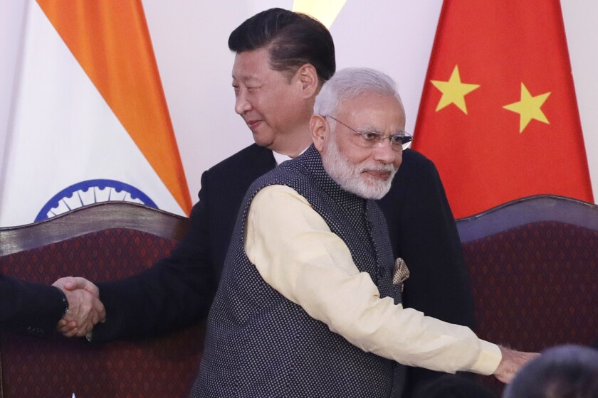 Chinese President Xi Jinping and Indian Prime Minister Narendra Modi