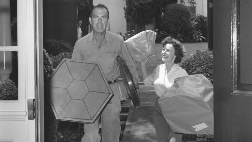 Fred MacMurray and June Haver move back into their Brentwood home.