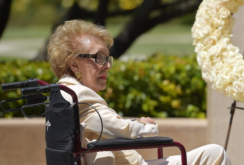 Former first lady Nancy Reagan visits the grave site of her husband, President Ronald Reagan, at the Ronald Reagan Presidential Library, Thursday, June 5, 2014, in Simi Valley, Calif. Today marks the 10th anniversary of President Reagan's passing. (AP Photo/Mark J. Terrill)
