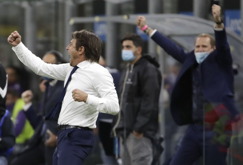 Inter Milan's head coach Antonio Conte celebrates at the end of the Serie A soccer match between Inter Milan and Fiorentina at the San Siro stadium in Milan, Italy, Saturday, Sept. 26, 2020. (AP Photo/Luca Bruno)