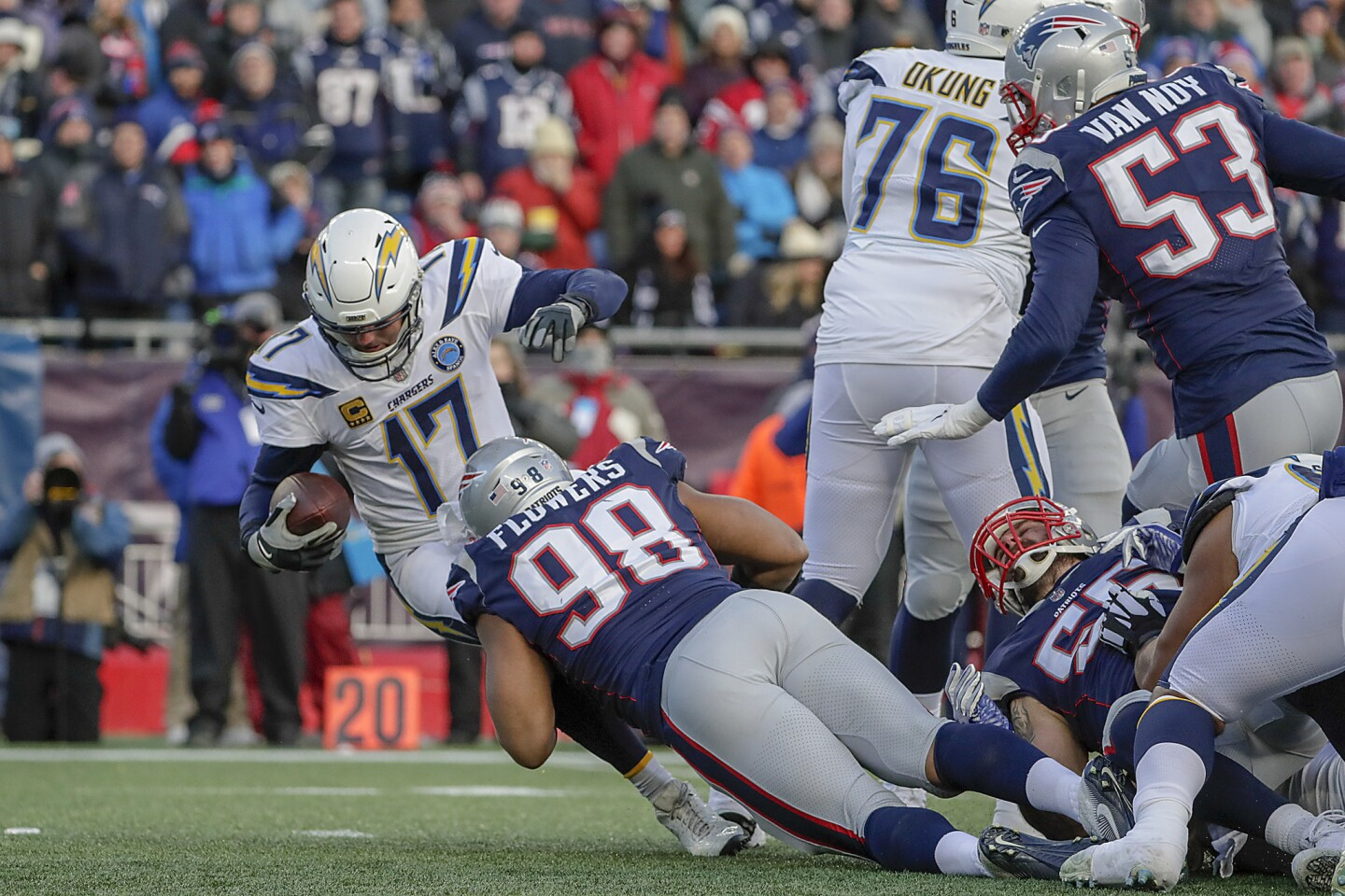Chargers quarterback Philip Rivers is sacked by New England Patriots defensive lineman Trey Flowers late in the second quarter in the NFL AFC Divisional Playoff at Gillette Stadium on Sunday.
