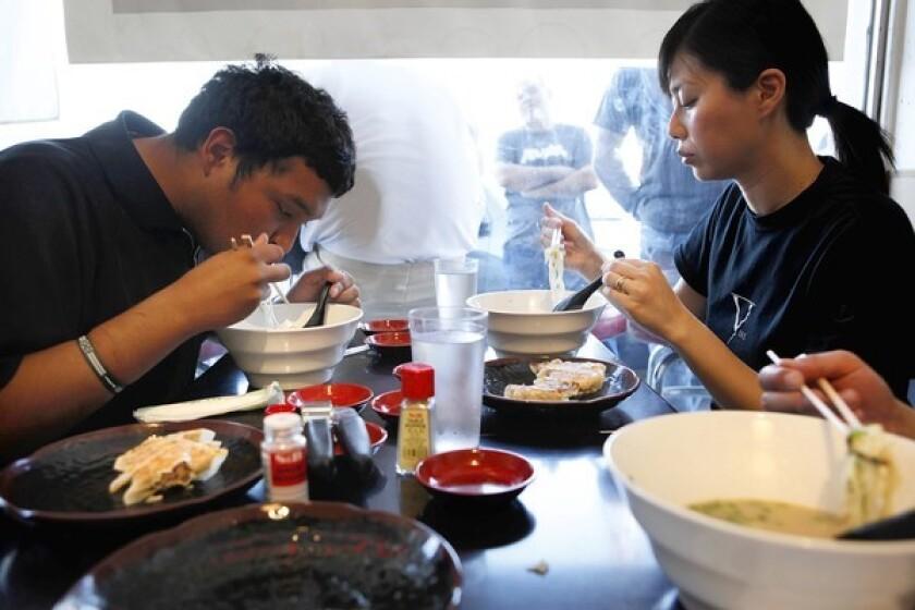 Sam Estrada, 23, left, and Jenny Chen, 33, eat Tonkotsu ramen at Ramen Yamada in Torrance.