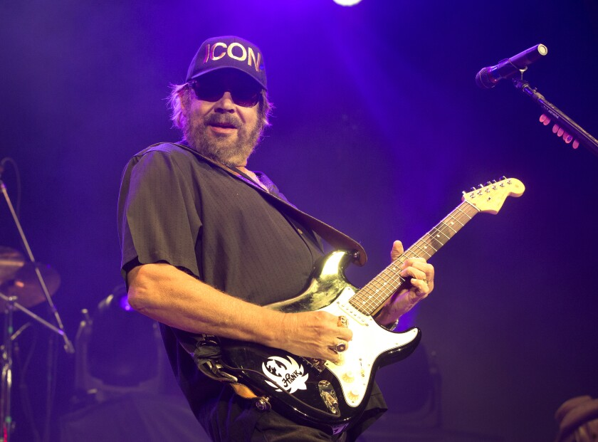 FILE - Hank Williams, Jr. performs in concert at The BB&T Pavilion in Camden, N.J. on Aug. 19, 2017. Williams, along with Dean Dillon and Marty Stuart, will be inducted into the Country Music Hall of Fame. (Photo by Owen Sweeney/Invision/AP, File)