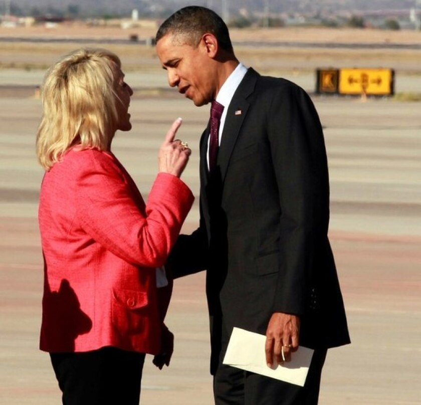 Arizona Gov. Jan Brewer and President Obama in an animated exchange at the airport in Phoenix.