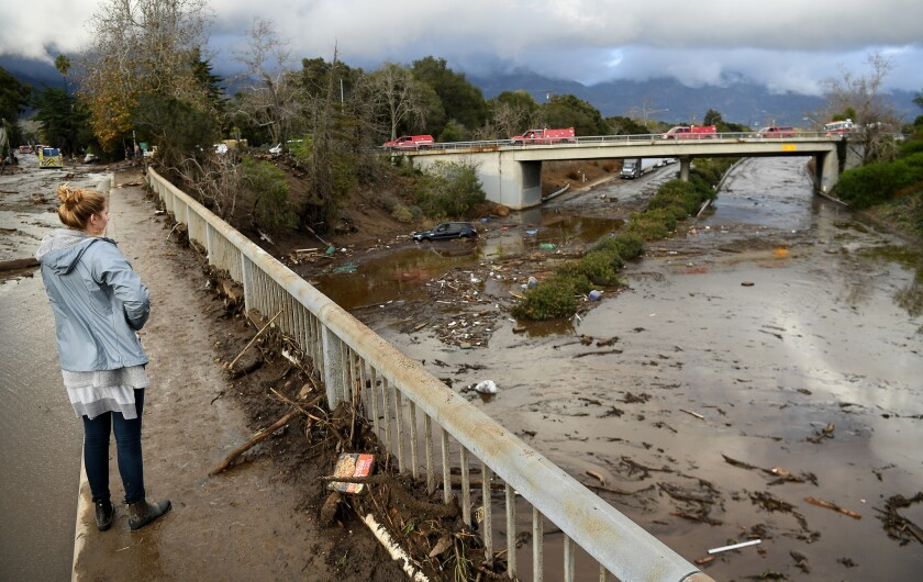 The 101 Freeway is flooded with mud and debris at Olive Mill Road in Montecito.