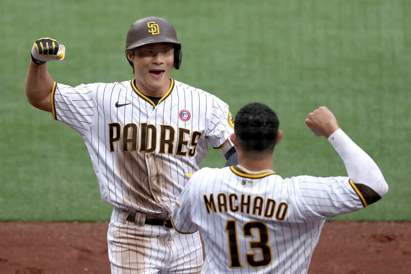 Manny Machado congratulates Ha-seong Kim after Kim's solo home run