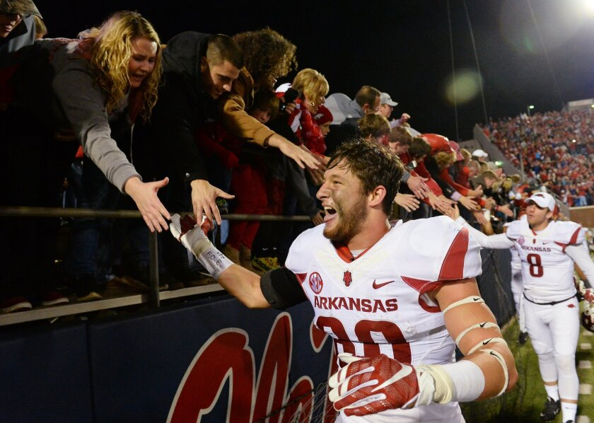 Arkansas wide receiver Drew Morgan (80) celebrates with fans after an NCAA college football game against Mississippi in Oxford, Miss., Saturday, Nov. 7, 2015. Arkansas won 53-52 in overtime. (AP Photo/Thomas Graning)