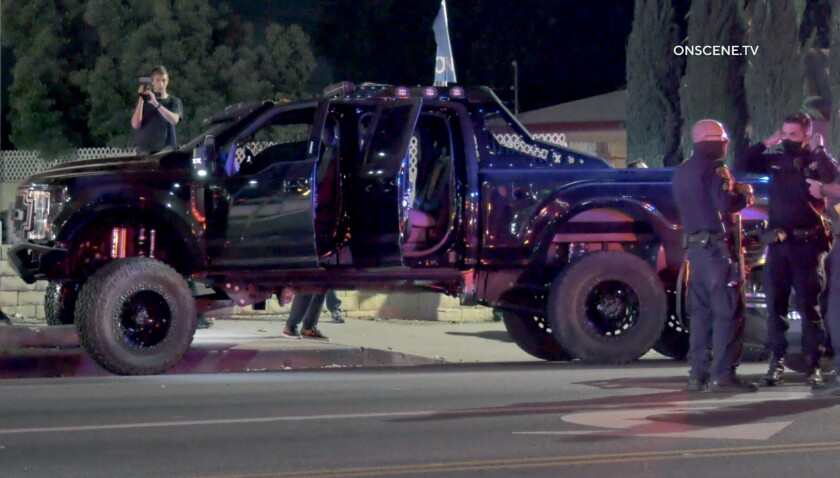 CHP officers chased a truck before the driver crashed into a light pole in Valley Glen.
