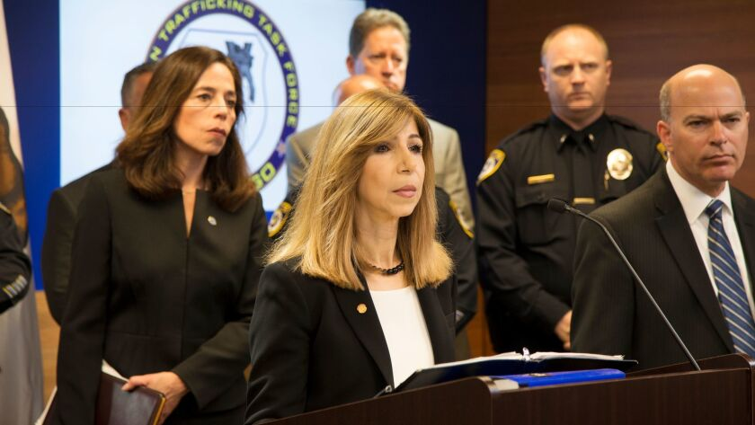 San Diego Chief Deputy District Attorney Summer Stephan (at the podium) announces the results of a multi-agency operation across California to stop the sexual exploitation of young women and girls.