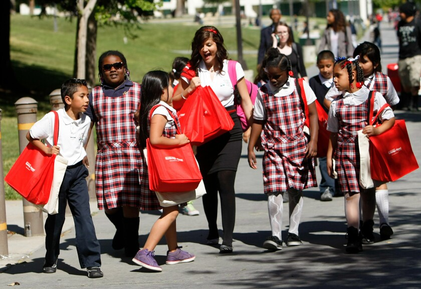 A teacher walks with her students from Wisdom Academy on a field trip to Cal State Northridge in 2013.