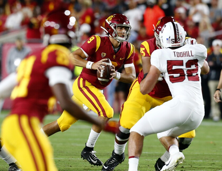 USC quarterback Kedon Slovis looks for an open receiver downfield against Stanford in the first quarter at the Coliseum on Saturday.