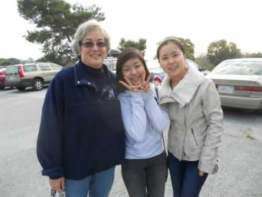 Lisa Shaffer (left) with the students she hosted for thanksgiving last year. Courtesy
