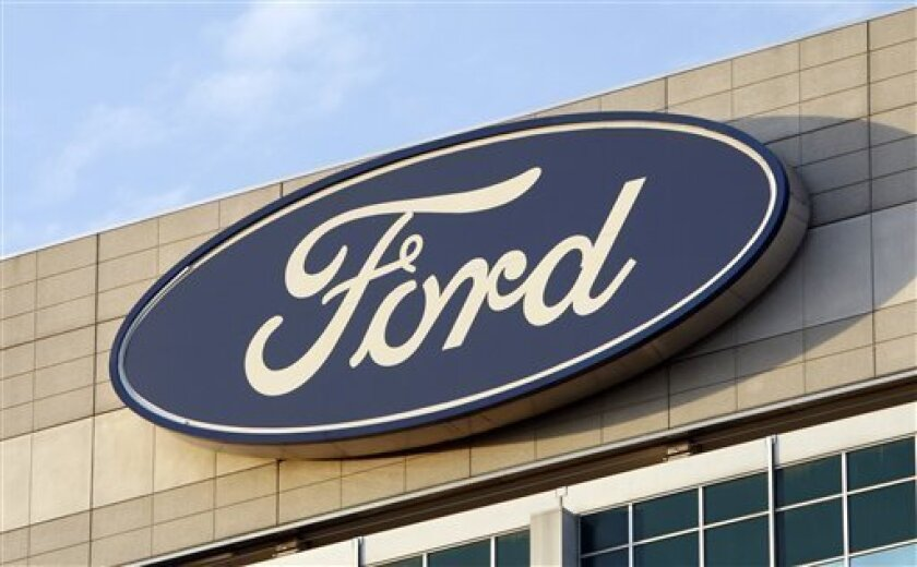 In this Oct. 26, 2009 photo, the Ford logo is seen on the automaker's headquarters in Dearborn, Mich. Workers at two more United Auto Workers locals overwhelmingly rejected changes to their contract with Ford Motor Co. on Thursday Oct. 29, 2009, casting further doubt on whether the deal will be approved.(AP Photo/Carlos Osorio)
