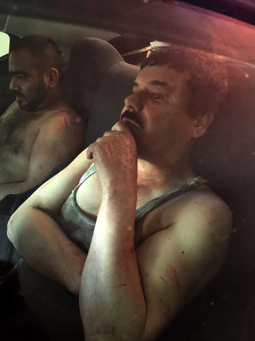 "The Mexican website Plaza de Armas published this photograph of Joaquin ""El Chapo"" Guzman, right, after his capture Jan. 8, 2016."