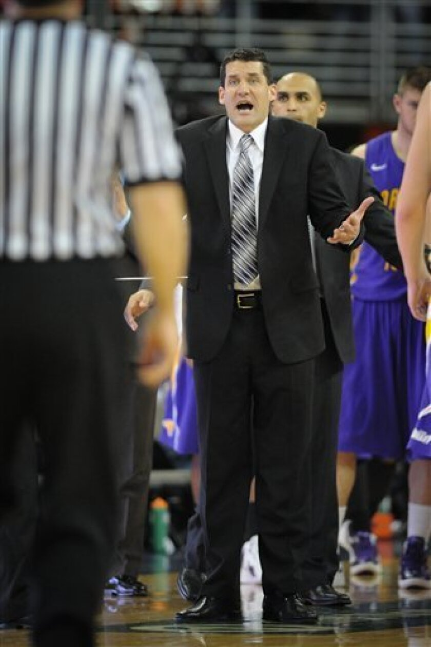 Northern Iowa's coach Ben Jacobson, center, pleads a call during their NCAA college basketball game against Creighton, Tuesday, Jan. 10, 2012, in Omaha, Neb. (AP Photo/Dave Weaver)