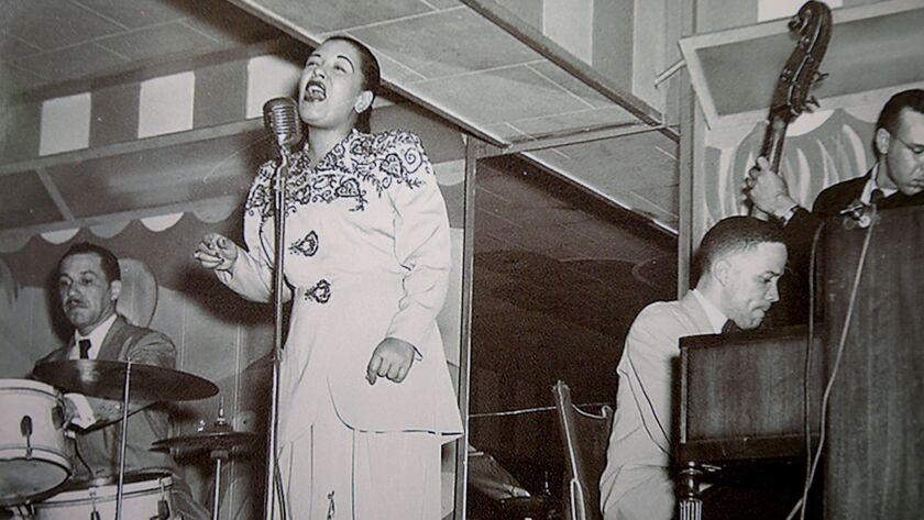 Billie Holiday, seen here in a photograph hanging at the Dunbar Hotel in South Los Angeles, is among the musicians whose master recordings were destroyed in a 2008 fire at Universal Studios Hollywood, a loss long hidden from public knowledge.