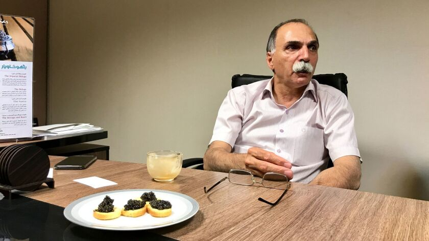 Nasser Meshkin Azarian, chairman of Bahoo Caviar, shares a plate of Iranian beluga caviar in his Teh