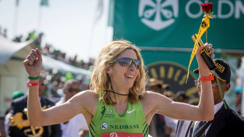 United States long-distance runner Camille Herron reacts after winning the 89km Comrades Marathon between Durban and Pietermaritzburg on June 4, 2017, in Pietermaritzburg. The annual ultra marathon this year attracted over 17,000 runners from around the world.