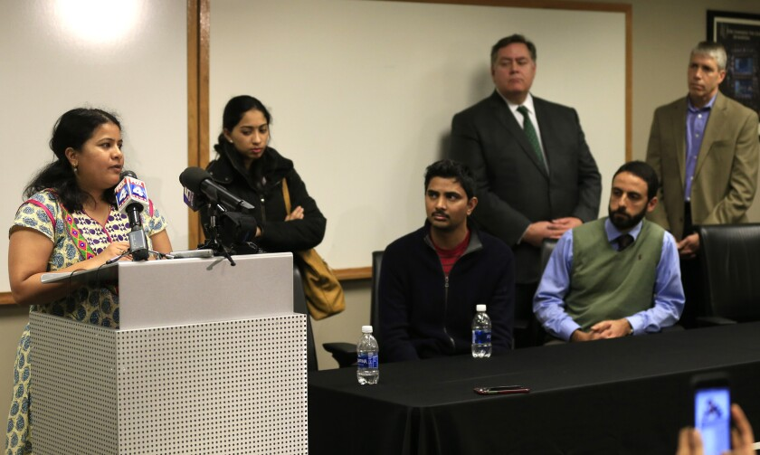 """Sunayana Dumala, left, talks about her late husband, Srinivas Kuchibhotla, during a news conference at Garmin Headquarters in Olathe, Kan., Friday, Feb. 24, 2017. Witnesses say a man accused of opening fire in a crowded bar yelled at two Indian men to """"get out of my country"""" before pulling the trigger."""