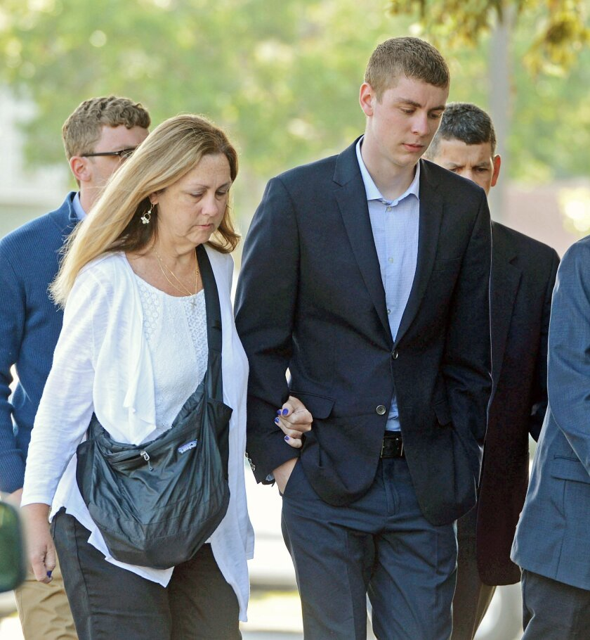 In this June 2, 2016 photo, Brock Turner, 20, right, makes his way into the Santa Clara Superior Courthouse in Palo Alto, Calif. The six-month jail term given to Turner, the former Stanford University swimmer who sexually assaulted an unconscious woman after both attended a fraternity party, is bei