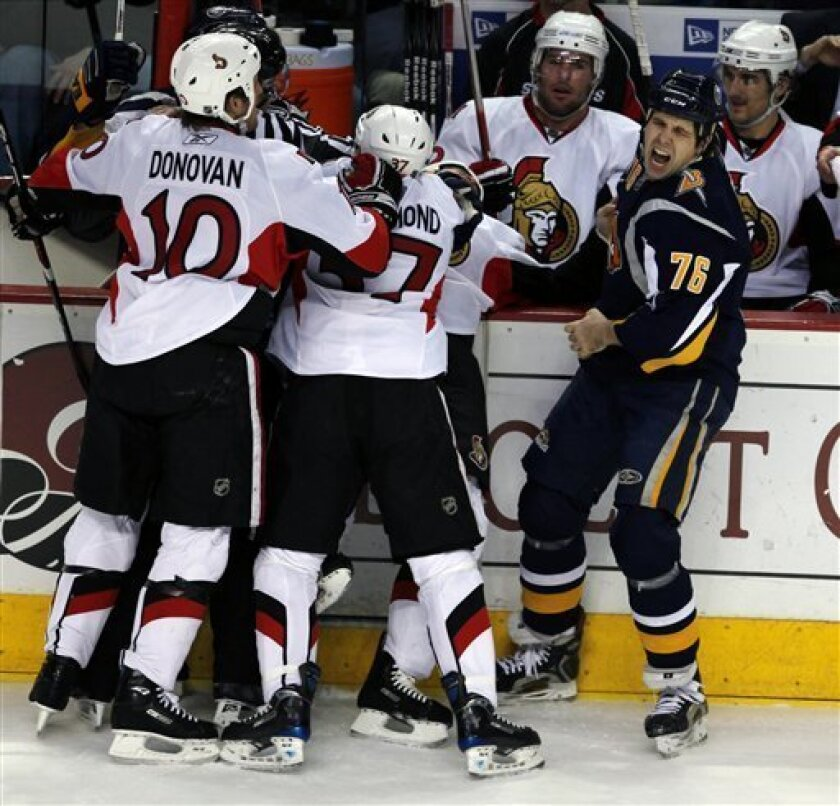 Buffalo Sabres' Jason Peters (76) grimaces after he was bit through the glove by Ottawa Senators' Jarkko Ruutu, not shown, of Finland, during the first period of the NHL hockey game in Buffalo, N.Y., Tuesday, Jan. 6, 2009. (AP Photo/Dean Duprey)
