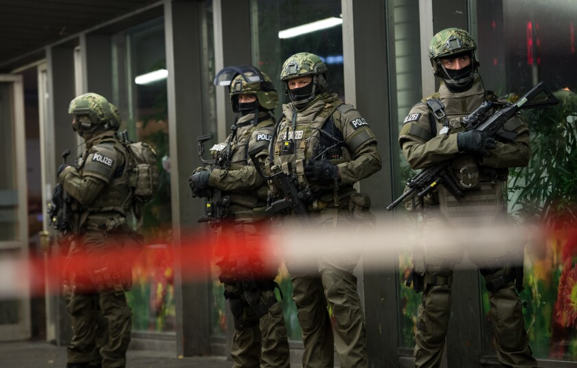 German special police stand in front of the Munich, southern Germany, main train station after police warned of 'imminent threat' of terror attack and ordered two train stations to be cleared.