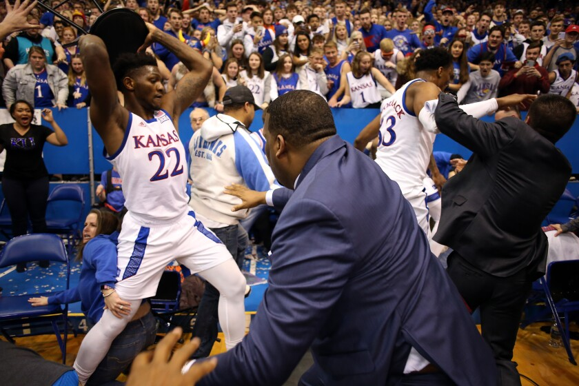 Kansas forward Silvio De Sousa grabs a stool during a brawl which broke out at the end of a Jayhawks game against Kansas State.