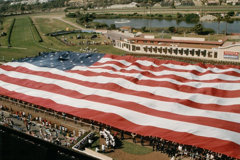 A Veteran's Day Salute at the Del Mar race track is set to include unfurling of one of the largest U.S. flags in the country – the famous Holiday Bowl flag.