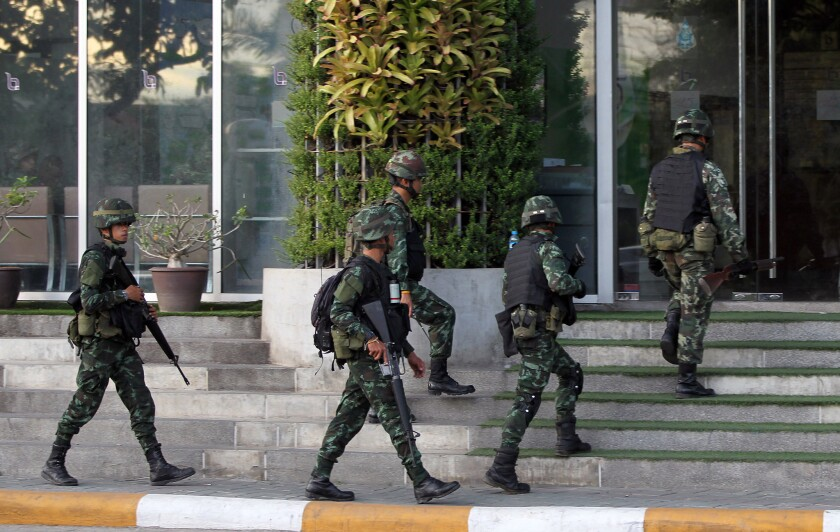 Soldiers enter the National Broadcasting Services of Thailand building in Bangkok, the capital. The army declared martial law in a surprise announcement.