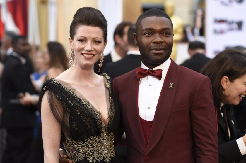 Jessica Oyelowo, left, and David Oyelowo arrive at the Oscars on Sunday, Feb. 22, 2015, at the Dolby Theatre in Los Angeles. (Photo by Chris Pizzello/Invision/AP)