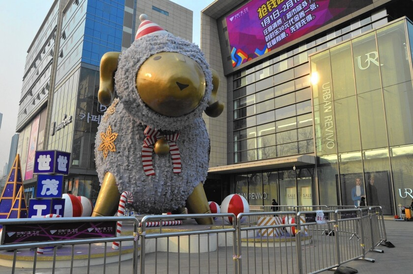 A giant ram or sheep statue stands outside a shopping center in Beijing. China will usher in the year of the sheep on Feb. 19.