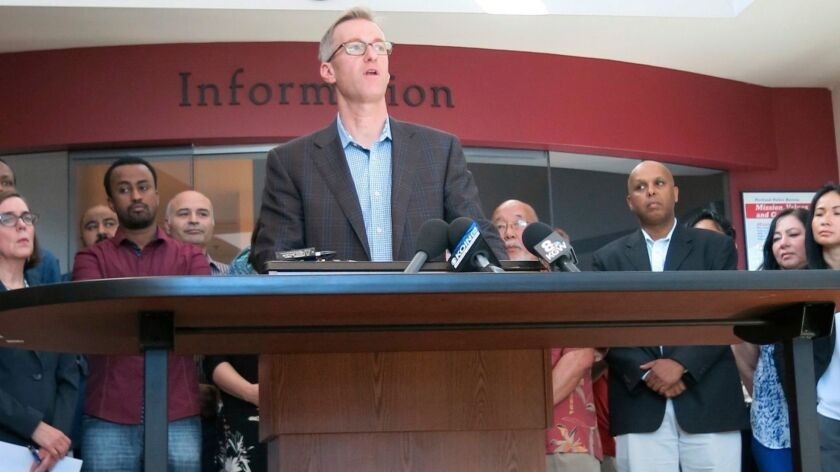 Portland, Ore., Mayor Ted Wheeler speaks at a news conference on Saturday after a man fatally stabbe